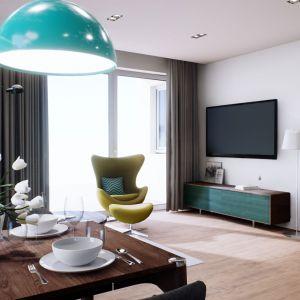 Salon połączony jest z jadalnią oraz ergonomiczną kuchnią. Projekt: pracownia Archipelag