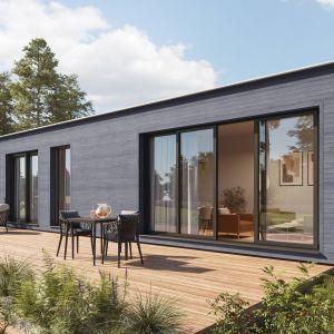 Ze względu na elastyczność oraz lekkość paneli po Kerrafront sięgają często zwolennicy budownictwa mobilnego. Na zdjęciu: Kerrafront Wood Effect Concrete Oak. Fot. Vox