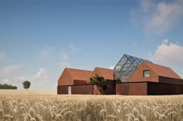 Dom w stylu nowoczesnej stodoły usytuowany jest w samym sercu pól uprawnych. Został zaprojektowany dla rodziny nowoczesnych rolników mieszkających gdzieś na wschodzie Polski. Robi niesamowite wrażenie!<br /><br />