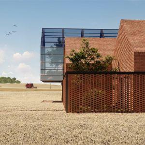 Elewacja pokryta czerwoną cegłą sprawia, że budynek wtapia się w otoczenie, dynamicznie zmieniające się wraz z porami roku. Projekt: pracownia Core