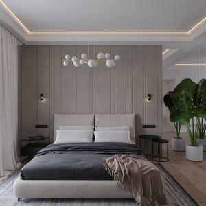Obecnie niezwykle modne są zagłówki tapicerowane, także w dużych rozmiarach poprowadzone na cała długość lub wysokość ściany za łóżkiem.  Projekt NABOO STUDIO