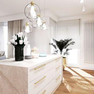 W otwartym salonie możesz zastosować ten sam materiał na podłodze w kuchni i w części wypoczynkowej. Projekt: Decoroom - arch. wnętrz Olga Nowosad-Szewców