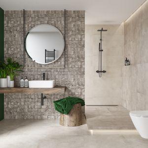 Łazienka ze ścianą w butelkowej zieleni. Na zdjęciu kolekcja Nerina Slash Opoczno