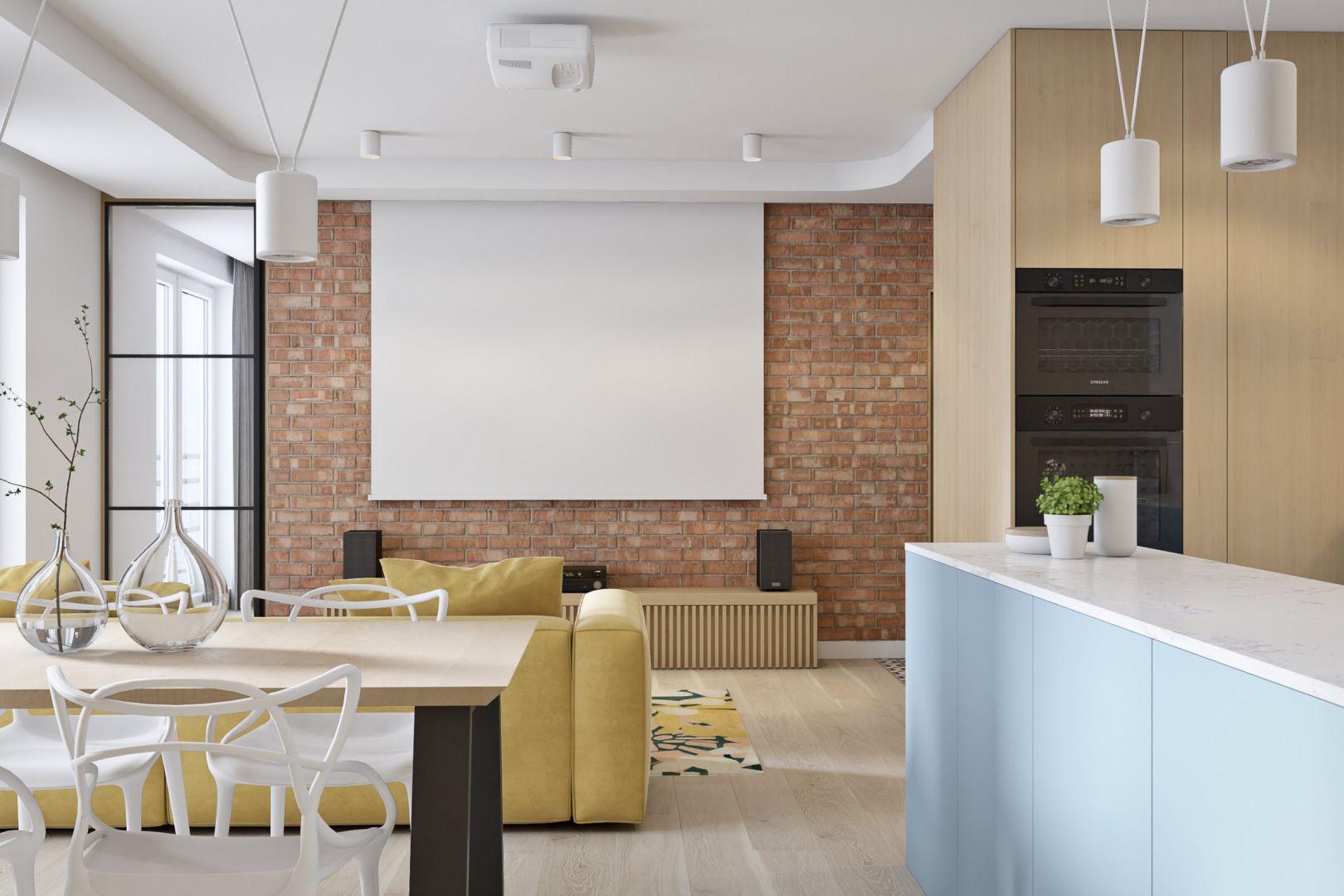 Ścianę za projektorem w salonie zdobi cegła. Projekt i wizualizacje: Mateusz Limanówka, Spacja Studio