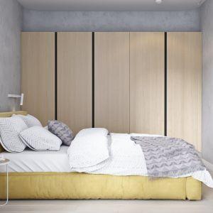 W sypialni wygospodarowano miejsce na pojmną szafę. Projekt i wizualizacje: Mateusz Limanówka, Spacja Studio
