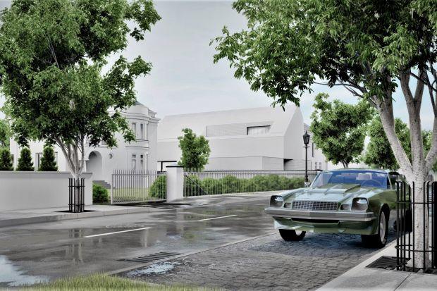 Biały domzostał zaprojektowanyzostał przez architektów z pracowni Core. Jego nowoczesna, prosta bryła nie idealnie wpisuje się w otoczenie, w którym dominują wille o tradycyjnej architekturze. To zasługa białego tynku i cegły zastosowanej n