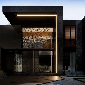 """Dom od frontu dom prezentuje się niezwykle okazale. Samo wejście główne zostało zaakcentowane przeszkleniami i prostą formą w kształcie odwróconej litery """"L"""". Projekt: Marcin Tomaszewski, REFORM Architekt"""