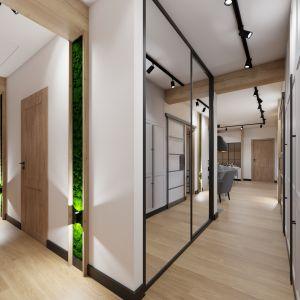 W holu znalazło się miejsce na duże, pojemne szafy. Projekt i wizualizacja: Donata Gadalska, DG Studio
