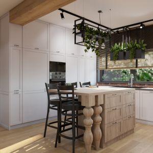 Tradycyjny charakter mebli i wykończenia w kuchni przełamane zostały bardziej nowoczesnymi dodatkami. Projekt i wizualizacja: Donata Gadalska, DG Studio