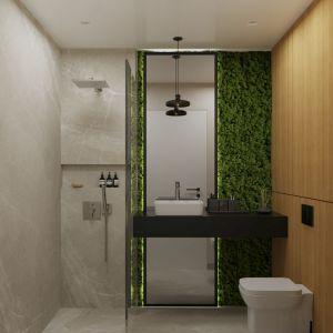 Во второй ванной комнате ждет сюрприз - зеленая стена, покрытая мхом.  Выглядит очень эффектно и не требует особого ухода, ведь растения не нужно поливать.  Все, что им нужно для жизни, - это влажность в помещении.