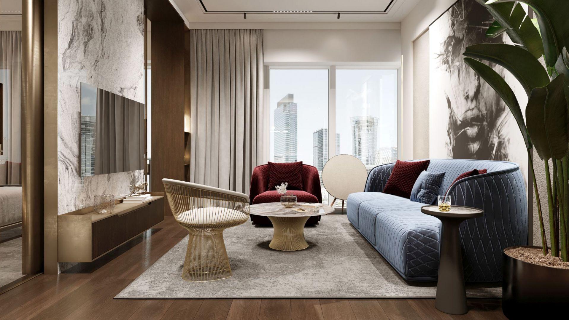 Sercem salonu jest sofa Redondo marki Moroso, która swoim kształtem przykuwa na myśl wizerunek klasycznych amerykańskich aut z lat 60. Projekt i wizualizacje: pracownia Soul Interiors