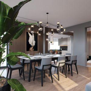 Do przestronnej jadalni można przedostać się zarówno z kuchni, jak i z salonu. Projekt i wizualizacje: kaim.work