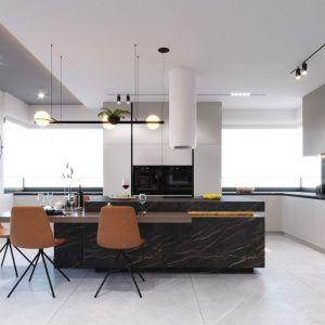 Na środku dużej kuchni znajduje się wyspa kuchenna. Projekt i wizualizacje: kaim.work