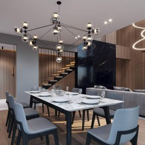 Wygodna jadalnia z dużym stołem i piękną lampą Projekt i wizualizacje: kaim.work