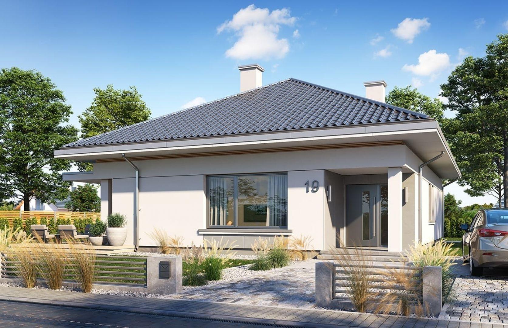 Dzięki zastosowanym detalom i materiałom dom jest oryginalny i prezentuje się wyjątkowo. Projekt: arch. Michał Gąsiorowski. Fot. MG Projekt