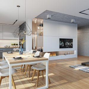 Wnętrze podzielono na jednoprzestrzenną powierzchnię połączonego salonu z jadalnią i kuchnią oraz na część nocną z trzema sypialniami. Projekt: arch. Michał Gąsiorowski. Fot. MG Projekt