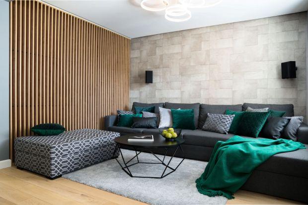 70-metrowe mieszkanie na warszawskim Czerniakowie zostało zaprojektowane dla 3-osobowej rodziny.Wnętrze jest nowoczesne, oszczędne w formie i bardzo wygodne. Biel, czerń i szarości, tworzą klimatyczną przestrzeń do życia.<br /><br /&