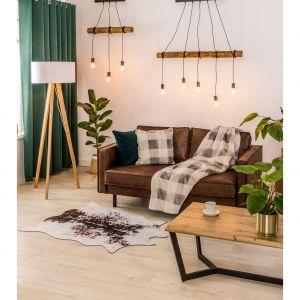 Grube dywany i ciepłe oświetlenie mogą umilić jesienno-zimowy czas i sprawić, że domowa przestrzeń stanie się przytulnym, klimatycznym miejscem. Fot. Salony Agata