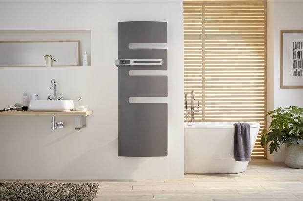 Jeśli chcesz wnieść do swojej łazienki nieco ciepła i designu - postaw na suszarkę elektryczną, która ma matowy odcień. Wyposażono ją w praktyczne i ozdobne ramię z panelem sterującym. Zapewni Ci bardzo szybkie odczucie ciepła - zyskasz 4 st